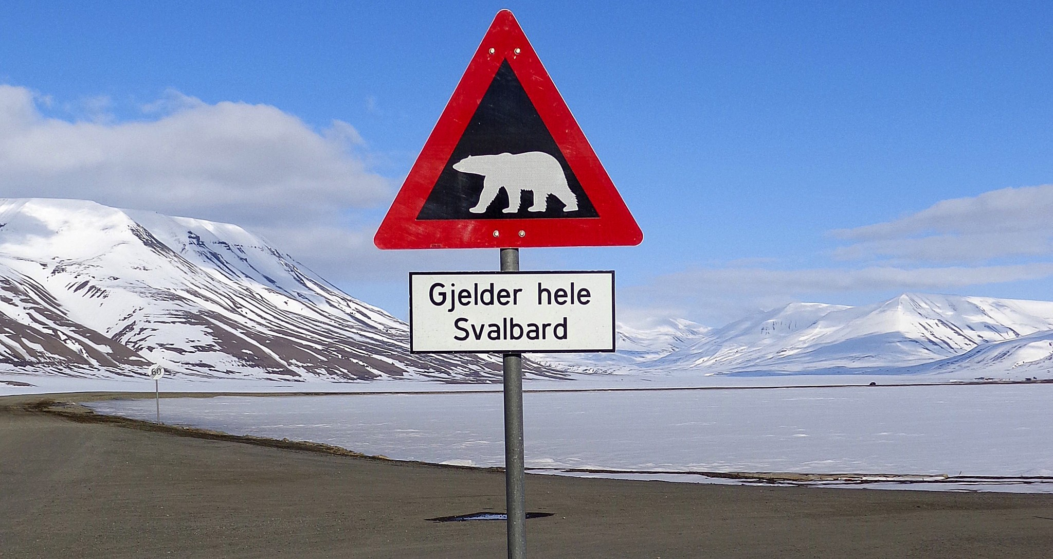 Sign warns residents of arctic Svalbard islands in Norway of danger from roaming polar bears