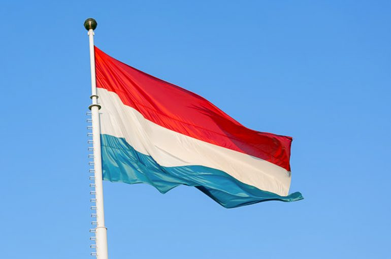 Flag of Luxembourg waving in the wind against blue sky (123rf.com)